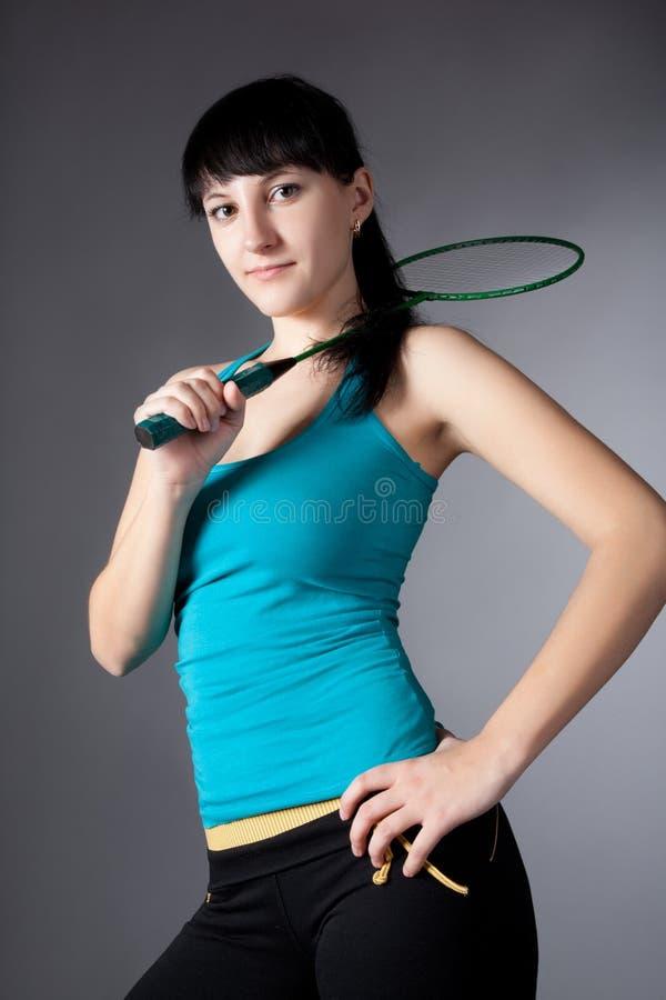 Mujer con la raqueta de bádminton fotos de archivo