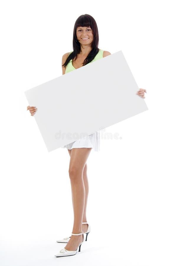 Mujer con la tarjeta blanca grande. fotografía de archivo