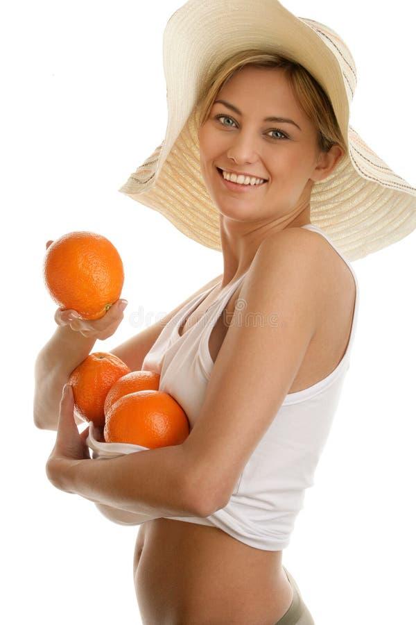 Mujer con las naranjas foto de archivo libre de regalías