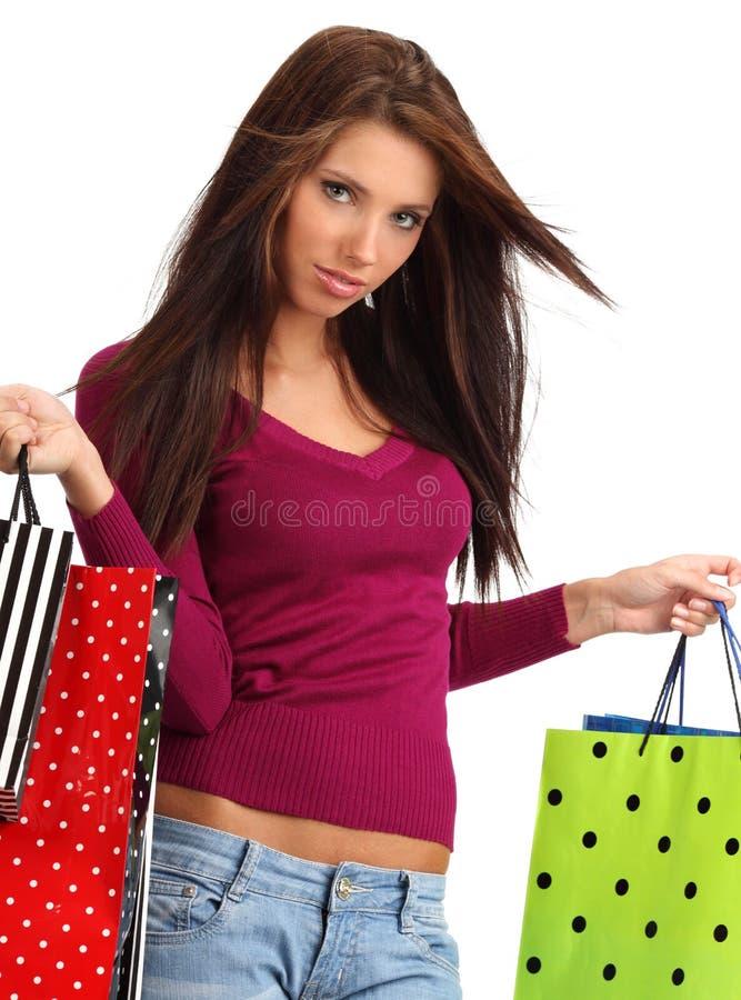 Mujer con los bolsos de compras. fotografía de archivo