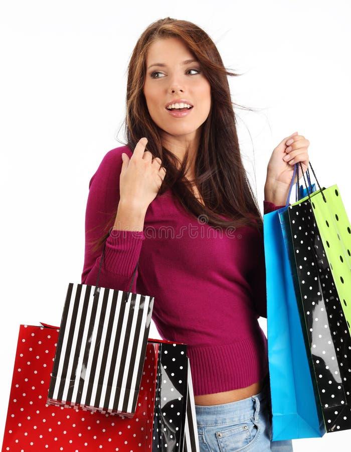 Mujer con los bolsos de compras coloridos fotos de archivo libres de regalías