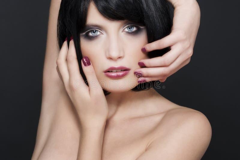 Mujer con maquillaje con estilo imagenes de archivo