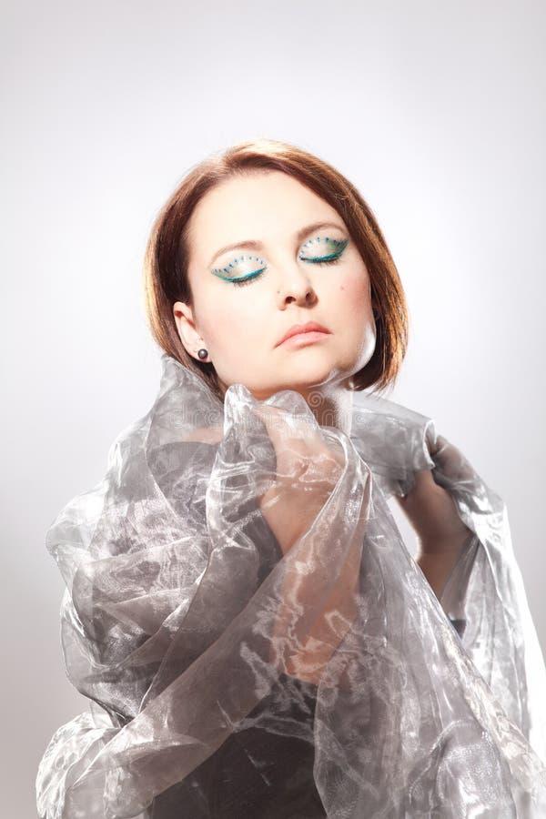 Mujer con maquillaje llamativo imagenes de archivo