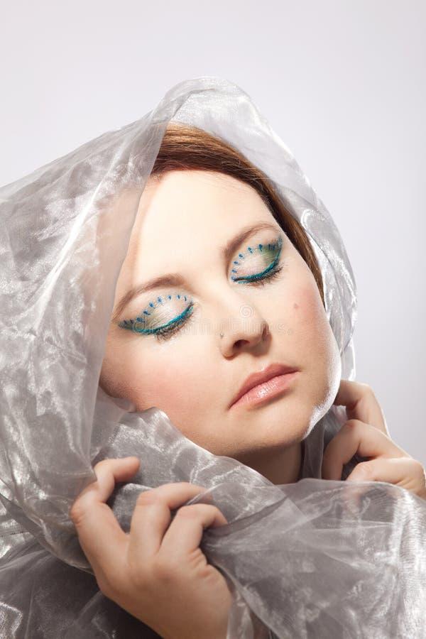 Mujer con maquillaje llamativo imagen de archivo