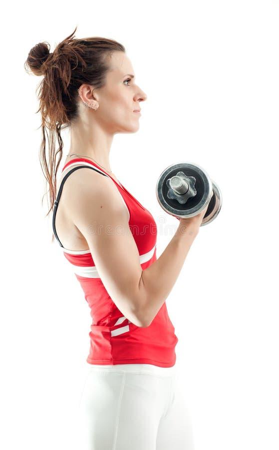 Mujer con pesas de gimnasia fotografía de archivo