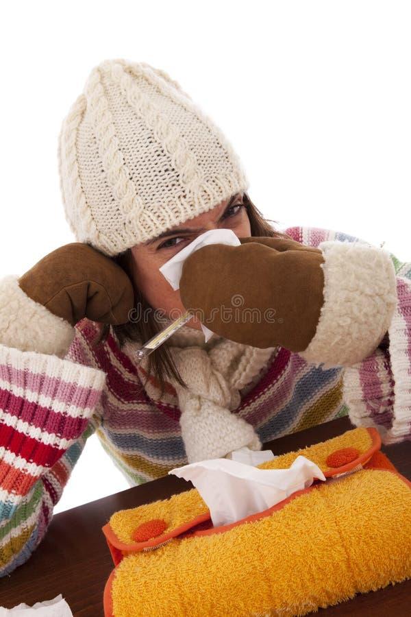 Mujer con síntomas de la gripe foto de archivo
