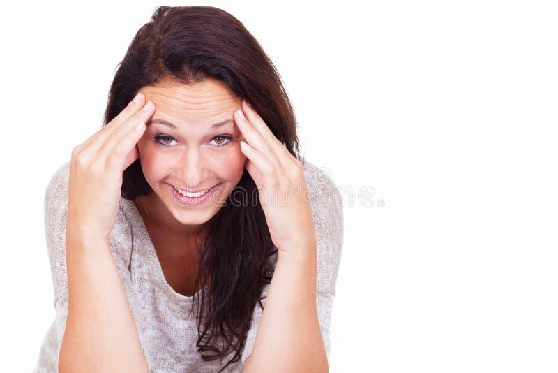 Mujer con un cierto dolor de cabeza foto de archivo libre de regalías