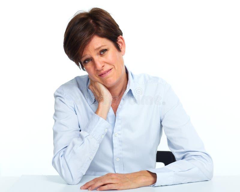 Mujer con un dolor de cabeza imagenes de archivo