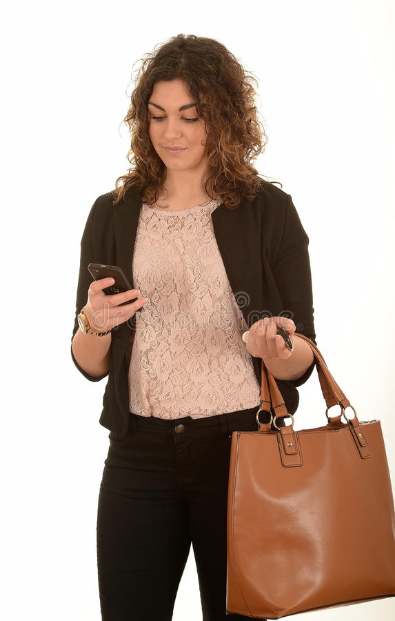 Mujer con un móvil fotos de archivo libres de regalías