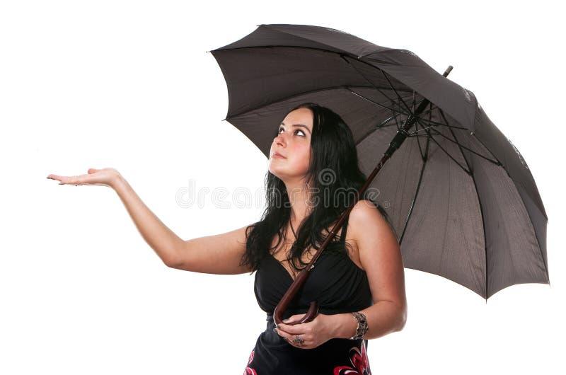 Mujer con un paraguas fotos de archivo