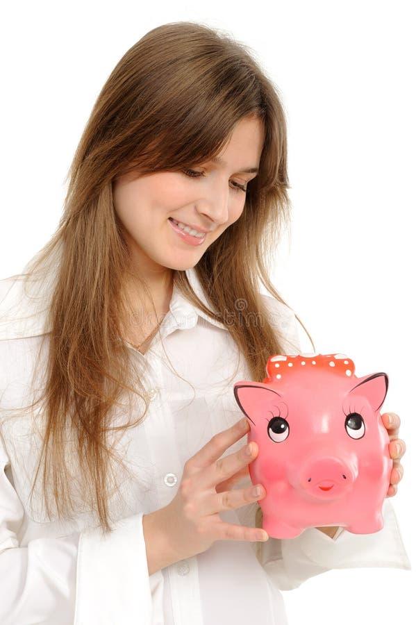 Mujer con un piggybank fotografía de archivo libre de regalías