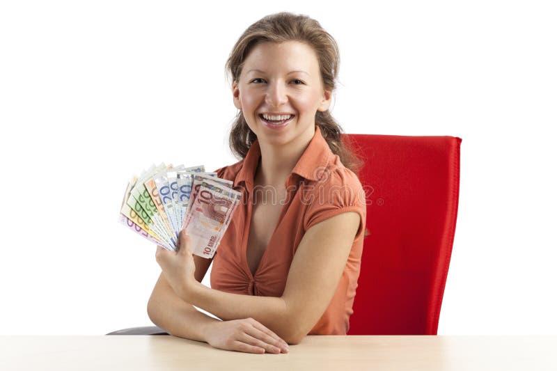 Mujer con un ventilador del dinero fotografía de archivo libre de regalías
