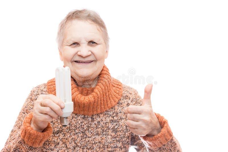 Mujer con una bombilla fotos de archivo