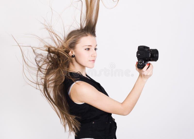 Mujer con una cámara de la foto fotos de archivo libres de regalías