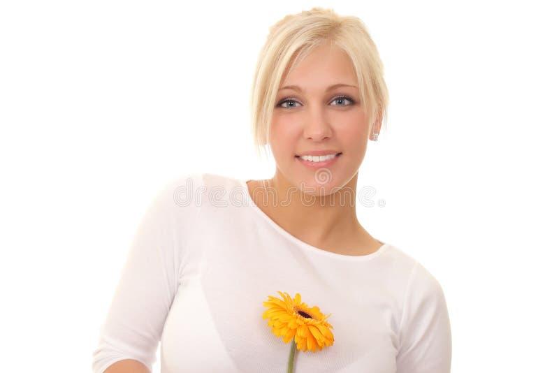 Mujer con una flor imágenes de archivo libres de regalías