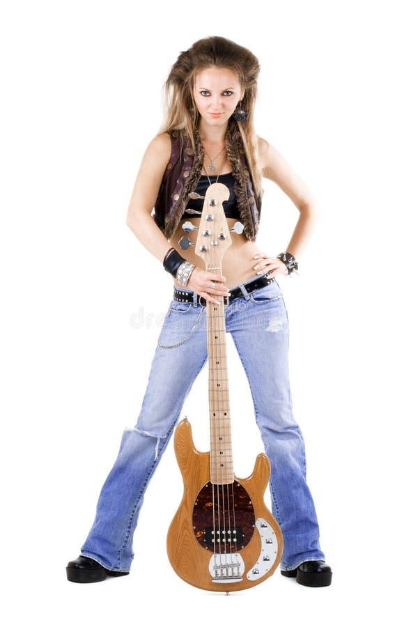 Mujer con una guitarra imagen de archivo libre de regalías