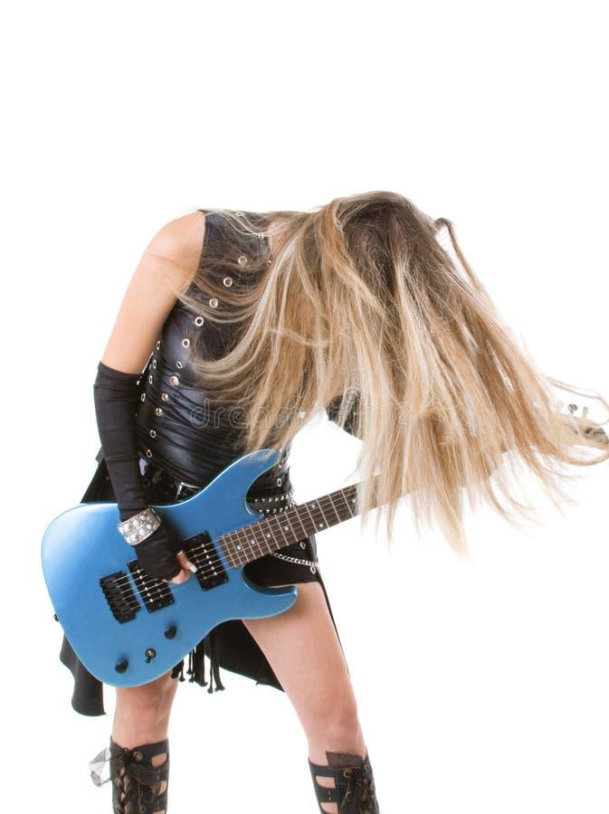 Mujer con una guitarra fotografía de archivo libre de regalías