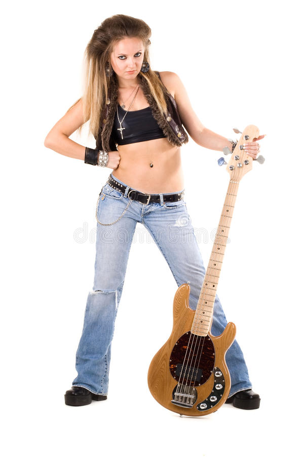 Mujer con una guitarra. Roca-n-ruede el estilo imagenes de archivo