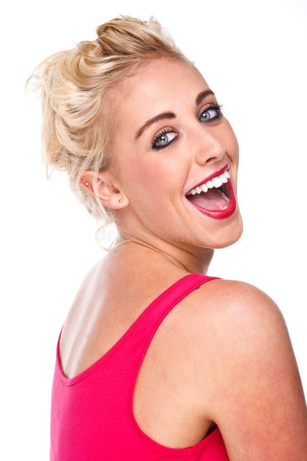 Mujer confidente atractiva que ríe con alegría imagen de archivo libre de regalías