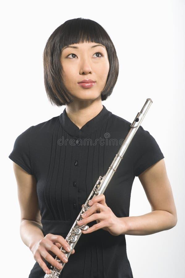 Mujer coreana que sostiene la flauta fotos de archivo