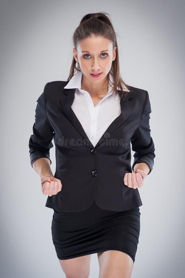 Mujer corporativa agresiva lista para hacer negocio fotos de archivo libres de regalías
