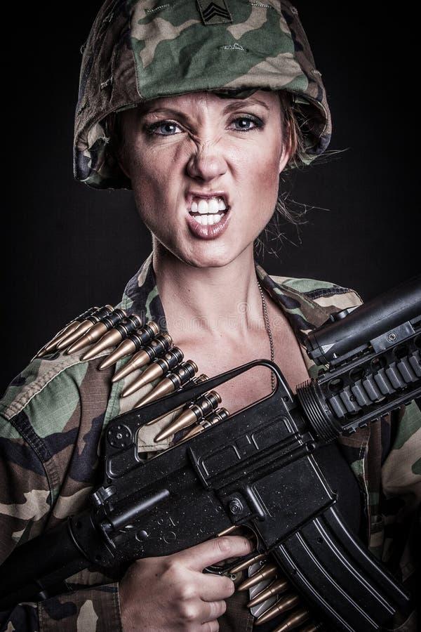 Mujer de la ametralladora imagen de archivo