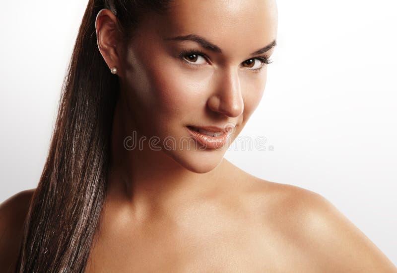 Mujer de la belleza con un pnytail fotografía de archivo