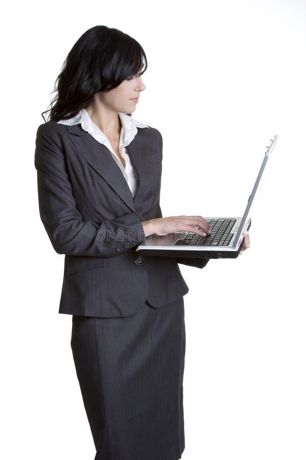 Mujer de la computadora portátil del asunto imagenes de archivo