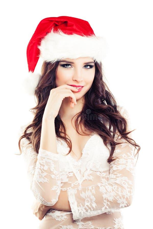 Mujer de la feliz Navidad en Santa Hat en blanco imagen de archivo libre de regalías
