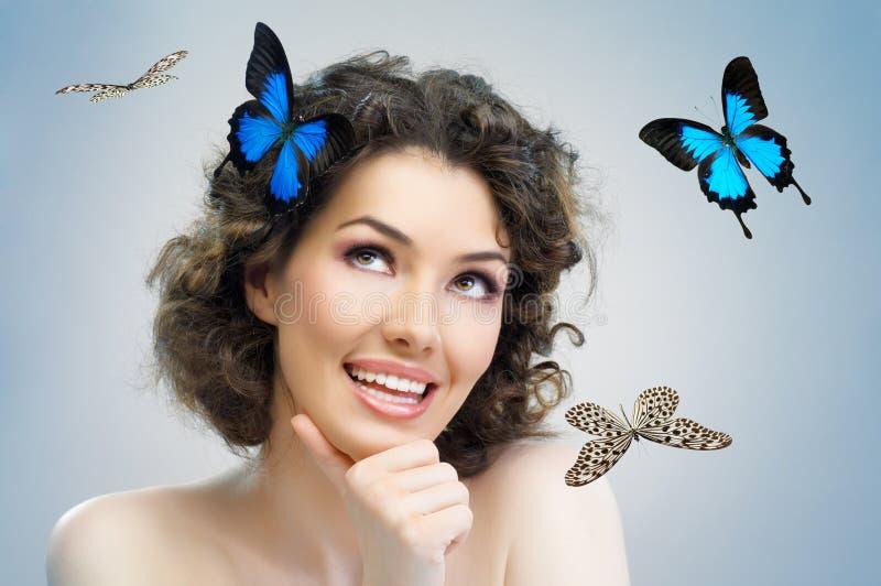 Mujer de la mariposa imagen de archivo libre de regalías