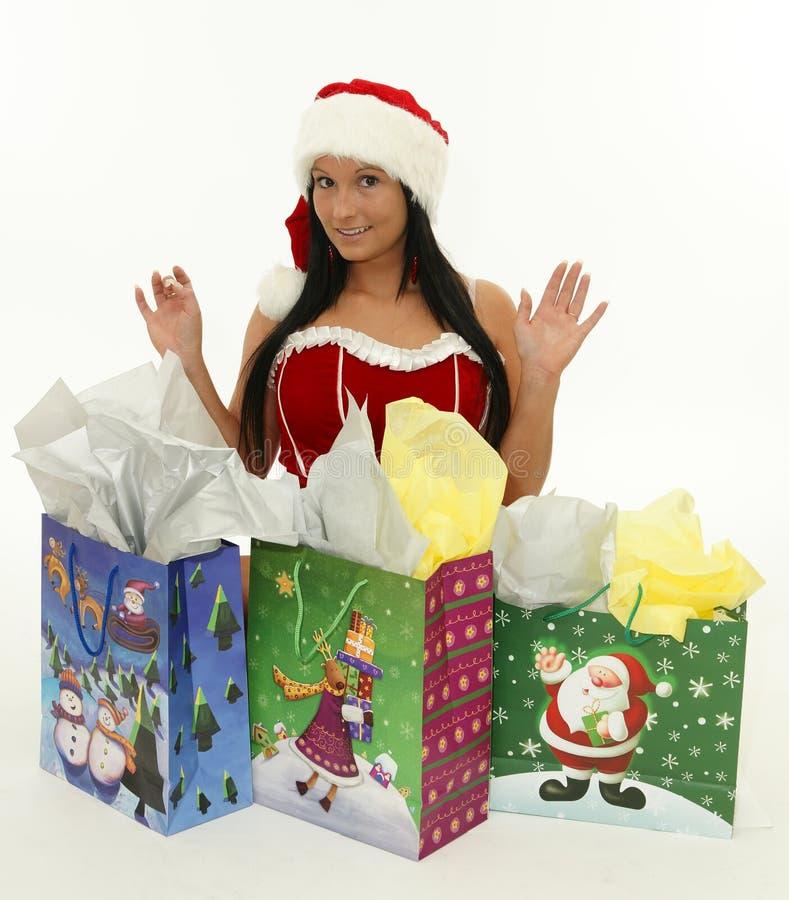Mujer de la Navidad con los regalos aislados imágenes de archivo libres de regalías