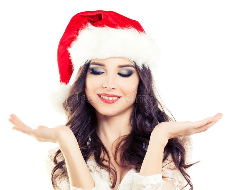 Mujer de la Navidad en Santa Hat en blanco fotos de archivo