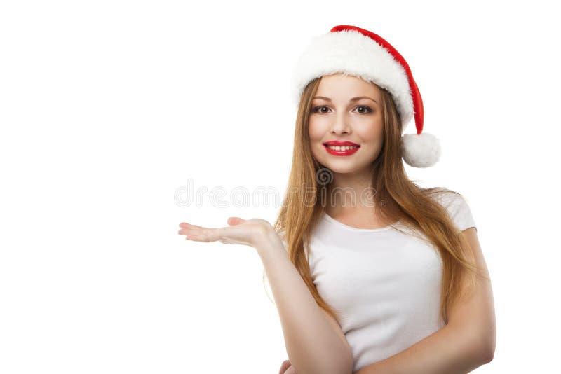 Mujer de la Navidad que lleva el sombrero de santa imagen de archivo libre de regalías