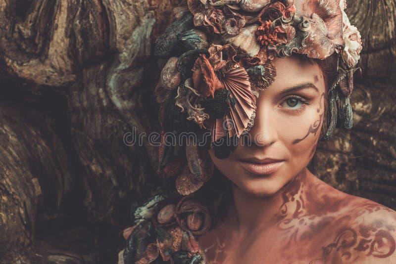 Mujer de la ninfa foto de archivo