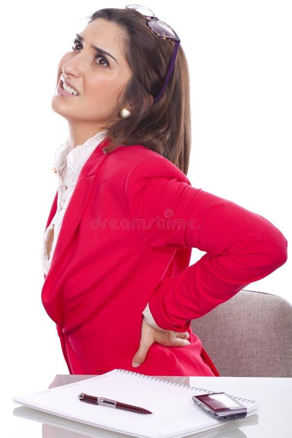 Mujer de la secretaria con dolor de espalda imagenes de archivo