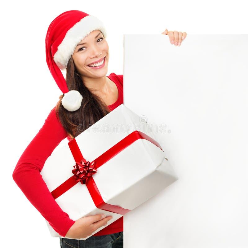 Mujer de la tarjeta de la muestra de la Navidad fotografía de archivo libre de regalías