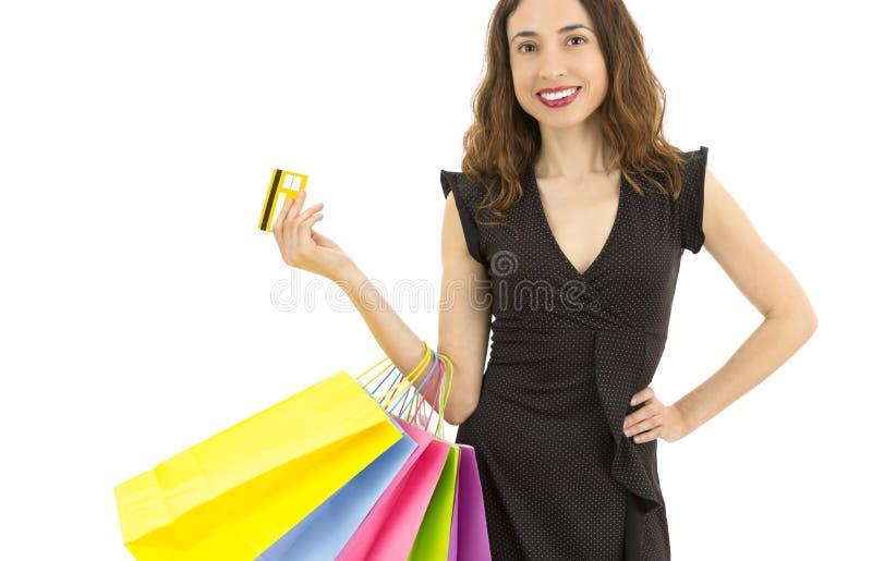 Mujer de las compras con su tarjeta de crédito imagen de archivo libre de regalías