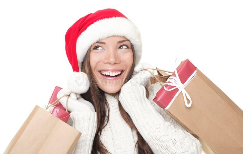 Mujer de las compras de la Navidad fotos de archivo