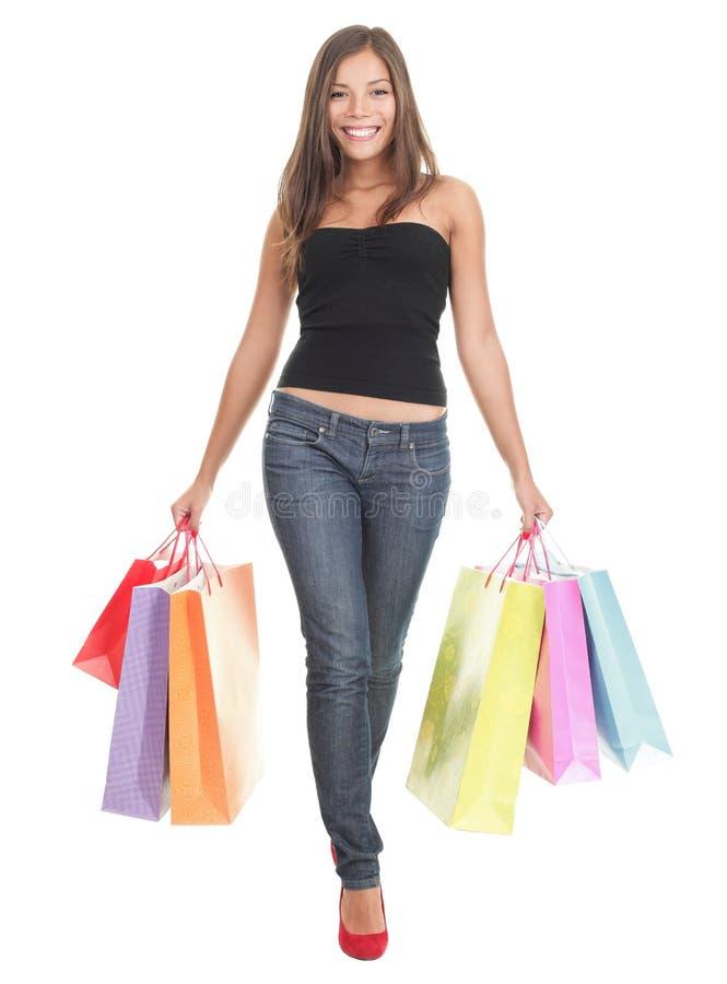 Mujer de las compras en el fondo blanco fotos de archivo libres de regalías