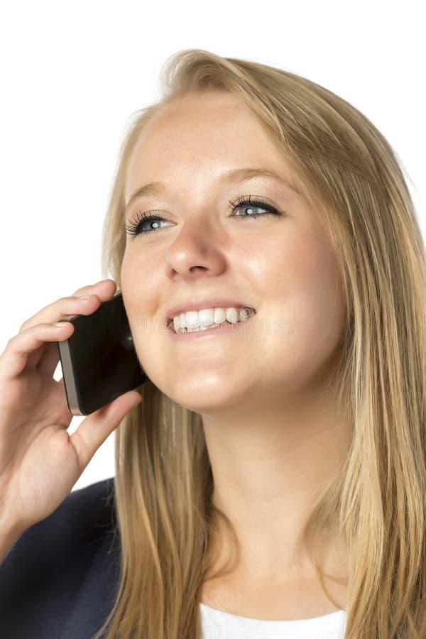Mujer de llamada telefónica rubia foto de archivo libre de regalías