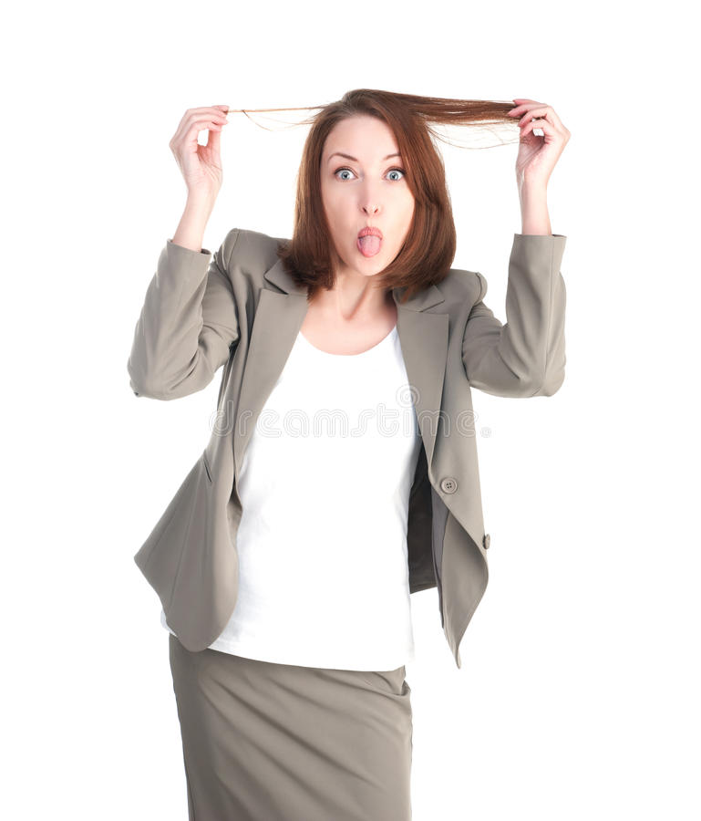 Mujer de los asuntos divertidos que muestra la lengua aislada foto de archivo libre de regalías