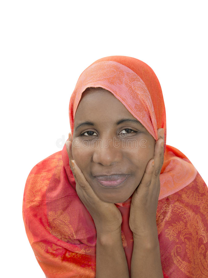 Mujer de mediana edad que lleva a cabo su cabeza en sus manos, aisladas foto de archivo libre de regalías