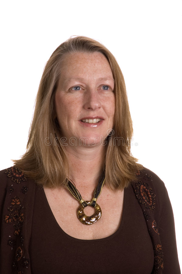 Mujer de mediana edad sonriente cómoda imagen de archivo