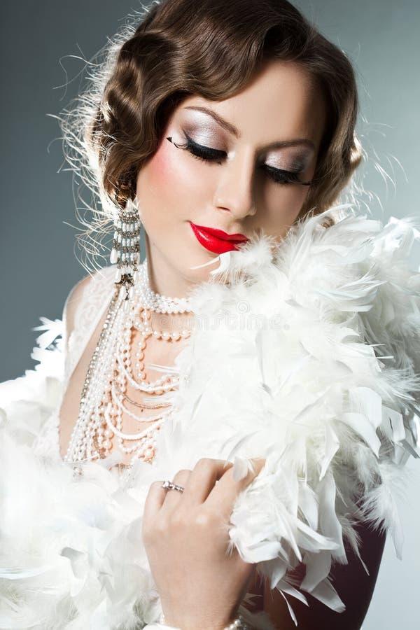 Mujer de moda con rostro del arte fotografía de archivo libre de regalías