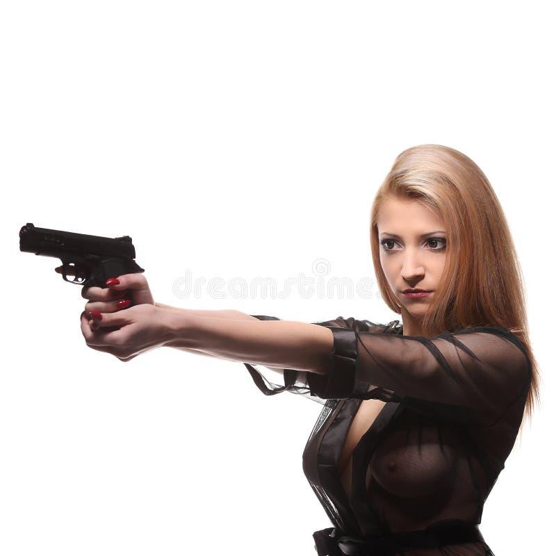 Mujer de moda elegante con un arma en manos fotografía de archivo