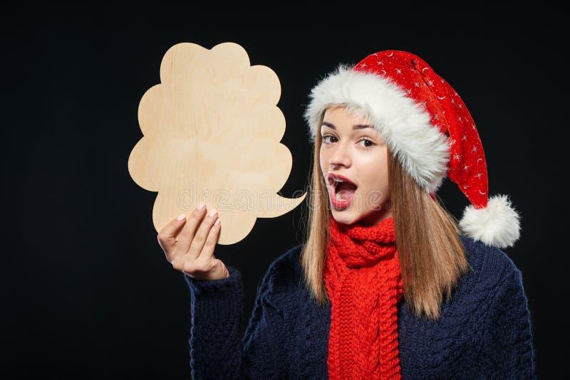 Mujer de Navidad con la burbuja del pensamiento fotografía de archivo
