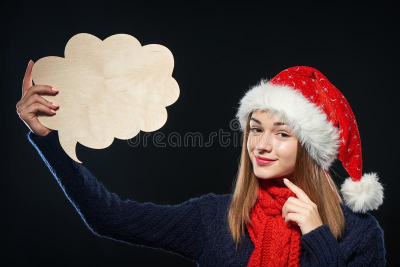 Mujer de Navidad con la burbuja del pensamiento foto de archivo