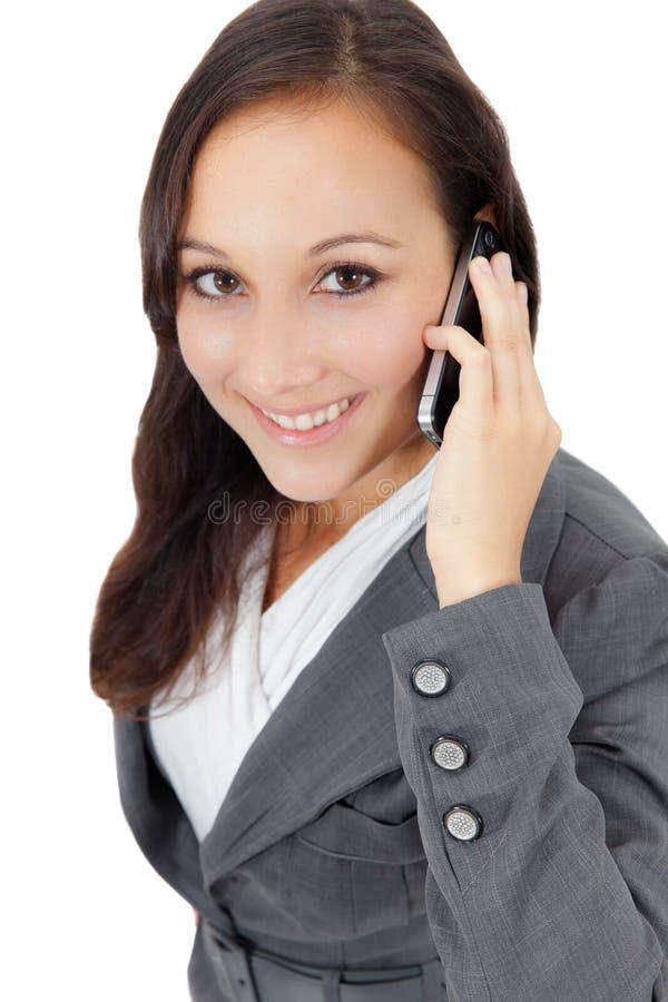 Mujer de negocios acertada que habla en el teléfono fotos de archivo libres de regalías