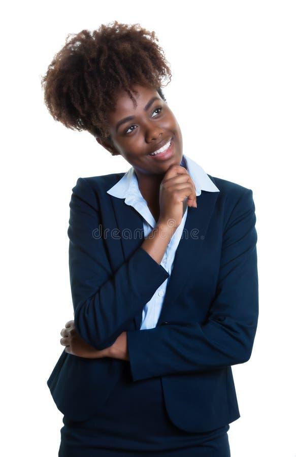 Mujer de negocios afroamericana de pensamiento imagenes de archivo