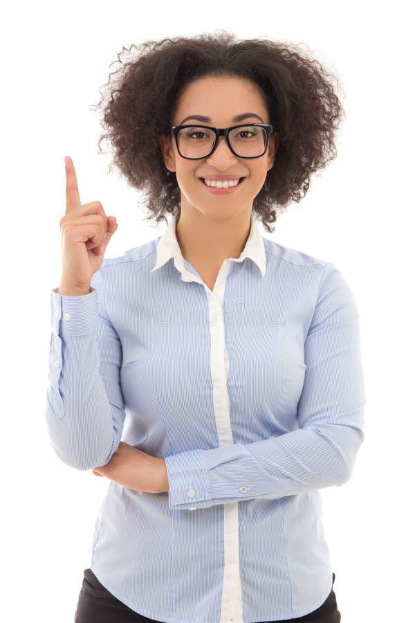 Mujer de negocios afroamericana hermosa que señala en algo fotos de archivo libres de regalías